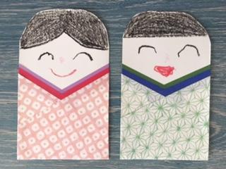 雛人形の顔と紙を書く